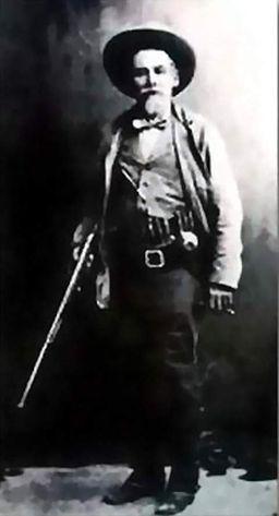 John Horton Slaughter with shotgun