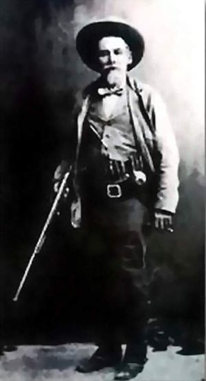 Augustine Chacon - John Horton Slaughter with his shotgun.