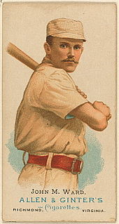 A baseball card showing a man holding a baseball bat over his left shoulder.