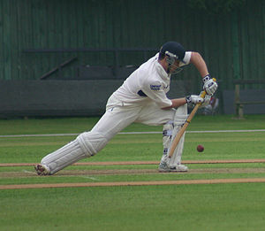 Batting (cricket) - Having taken a long stride, a batsman blocks the ball with a forward defensive shot.