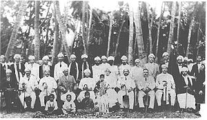 Justice Party (India) - Image taken in 1920s : Theagaroya Chetty is seated at the centre (to the immediate right of the girl). To his right is Arcot Ramaswamy Mudaliar. Also present are Raja of Panagal and Raja of Venkatagiri