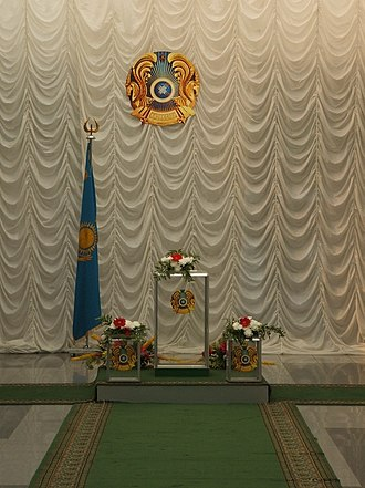 Elections in Kazakhstan - Ballot boxes, Kazakh flag and state seal in an Astana polling place before the 2007 legislative elections.