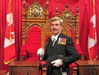 Parliament of Canada - Former Usher of the Black Rod, Kevin S. MacLeod, before the thrones in the Senate chamber, 2009