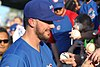 Kris Bryant signing autographs during his rehab assignment against Omaha (44315244361).jpg