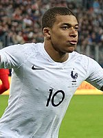Kylian Mbappe celebrating - March 2018 (cropped).jpg