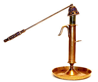Candle snuffer - A candle extinguisher in use