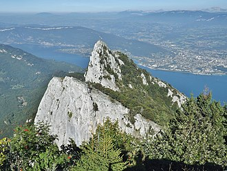 Dent du Chat - View of dent du Chat  from Molard Noir mountain, with lac du Bourget and Aix-les-Bains in the background.