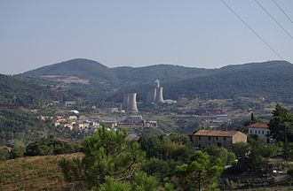 Geothermal power in Italy - View of Larderello with one of the biggest geothermal plant in Italy