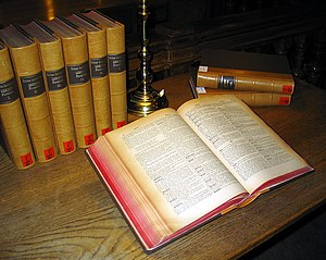 a multi volume Latin dictionary on a library table