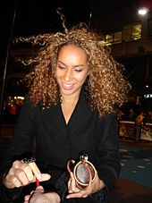 Colour photograph of Leona Lewis signing an autograph in 2006.