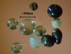 Micrometeorite - Figure 2. Light microscope images of stony cosmic spherules.