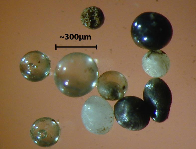 Light microscope images of stony cosmic spherules.