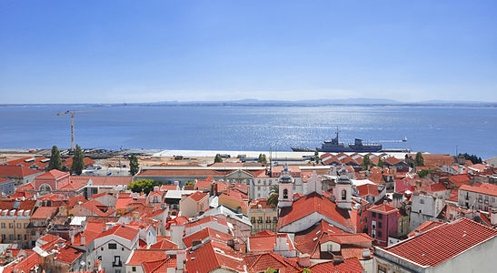 This is a morning view of the Tagus River and part of the Alfama District, from Santa Luzia Lookout, in Lisbon, Portugal. The picture was taken with a Nikon D90, with a 18-105 VR Nikkor Lens.