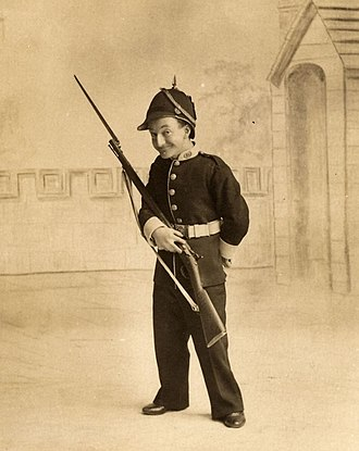 Little Tich - Little Tich on stage as a soldier in the 1890s
