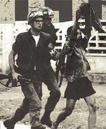 MPs escort a Vietcong captive out of the US Embassy on 31 January 1968.jpg