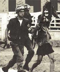 MPs escort a Vietcong captive out of the US Embassy on 31 January 1968