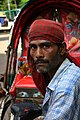 Man and cycle rickshaw, Dhaka.jpg