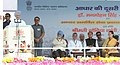 Manmohan Singh addressing at the launch of Aadhaar Enabled Service Delivery, on the occasion of 2nd anniversary of AADHAAR, in Dudu, Jaipur, Rajasthan. The Deputy Chairman, Planning Commission, Shri Montek Singh Ahluwalia.jpg