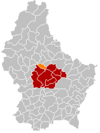 Map of Luxembourg with Colmar-Berg highlighted in orange, the district in dark grey, and the canton in dark red