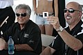 Mario Andretti and Bobby Rahal signing autographs at the Barber Legends of Motorsport 2010 2.jpg