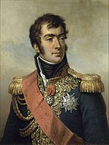 Portrait of man with heavy eyebrows in a blue military uniform with plenty of gold braid