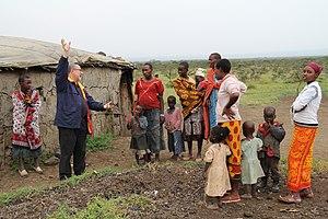 Firdaus Kharas - Firdaus Kharas describing solar lights to Masai villagers.