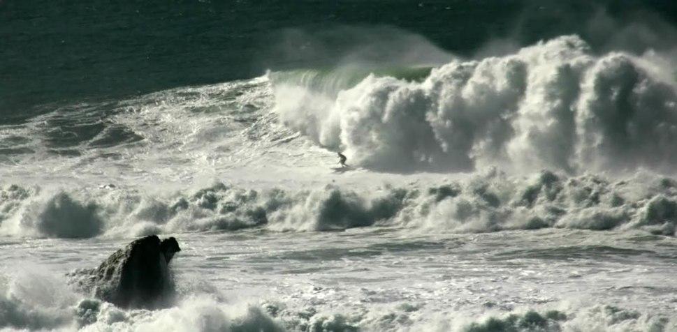 Mavericks and surfer