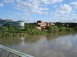 City hall, the courthouse and Medicine Hat Public Library are visible across the South Saskatchewan River, looking south from Finlay Bridge