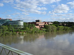 Medicine Hat - City hall, the courthouse and Medicine Hat Public Library are visible across the South Saskatchewan River, looking south from Finlay Bridge