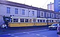 Milano tram 831 with trolley pole in 1983, hauling a Desio-bound train in Cusano.jpg