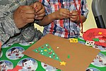 Military members, families enjoy Holiday party 161202-F-WF462-052.jpg