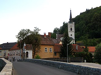 Mirna (settlement) - The central bridge over the Mirna River and the Gothic church of Saint John the Baptist