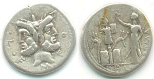 Furia (gens) - Silver Denarius of Marcus Furius Philo, 119 BC.  The obverse bears a head of Janus, while on the reverse Victoria, carrying a sceptre, places a wreath on a military trophy.