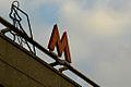 Moscow Metro sign (Знак Мосметро) (7157520048).jpg