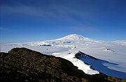 Mount Erebus, on Ross Island, is the largest volcano by volume, and second only to Mount Sidley in altitude, in Antarctica. This is a view from McMurdo Station.