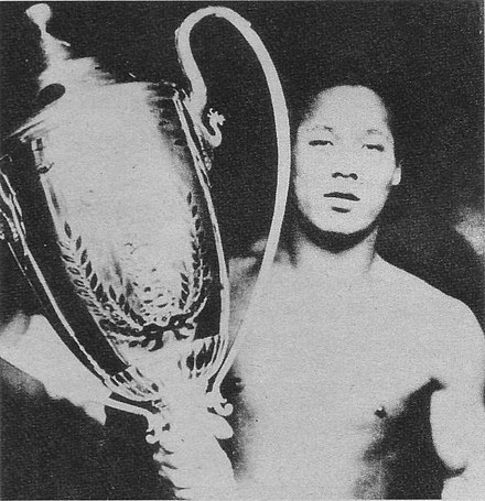 Musashiyama with the Emperor's Cup after winning the May 1931 tournament Musashiyama 1931 Scan10048.JPG