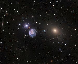 Photo of the 81 cm mirror telescope of the Mount Lemmon Observatory, NGC 2276 (left) and NGC 2300 (right)