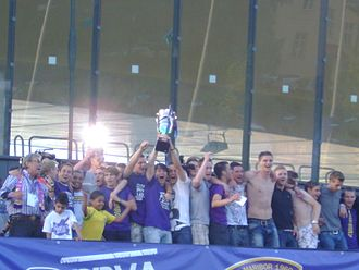 Slovenian PrvaLiga - PrvaLiga trophy being lifted in celebration of Maribor's ninth league title in May 2011.