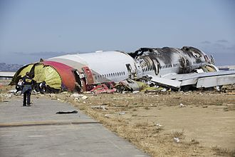 Asiana Airlines -  NTSB investigators looking at the fuselage of Asiana Airlines Flight 214 after it crash-landed in San Francisco (July 2013)