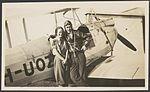 Nancy Bird and Jack Kingsford-Smith standing next to a de Havilland DH.60M Moth (VH-UOZ), Mascot (?), New South Wales, ca. 1933, 1 - E. A. Crome (15667330714).jpg