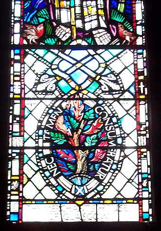 "Religion in Scotland - Stained glass showing the burning bush and the motto ""nec tamen consumebatur"", St. Mungo's Cathedral, Glasgow."