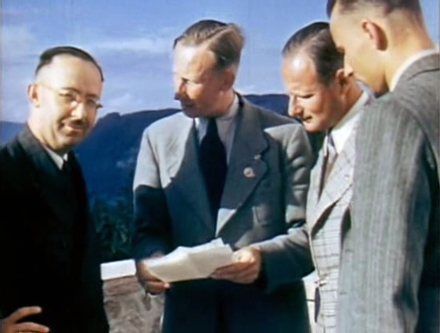 Holocaust perpetrators Heinrich Himmler, Reinhard Heydrich and Karl Wolff at the Berghof, from silent color film shot by Eva Braun, May 1939 Obersalzberg meeting - May 1939.png