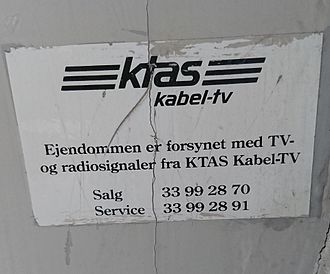 YouSee - Old sign from the former regional telephone company, KTAS, indicating that the building is connected with TV- and radio signals from KTAS