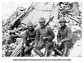 Ottoman officers sitting in front of debris of destroyed house in Maydos.jpg