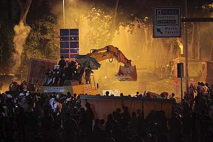 A bulldozer later nicknamed POMA was hijacked by Çarşı members and used against police forces' TOMA vehicles POMA Bulldozer Hijacked by Carsi at Gezi protests.jpg