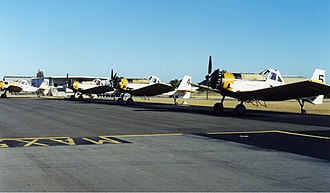 PZL-Mielec M-18 Dromader - Lineup of 4 M-18s at Perth Airport on standby for the bushfire season (early 2000s)