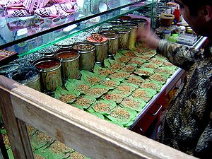 Shopkeeper making Paan in an Indian store