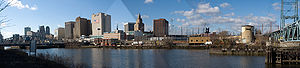 One Washington Park - Panorama of Newark from the Passaic River. Buildings at center are clustered around Washington Park. One Washington Park is red brick, northernmost (far right) high rise building in Downtown Newark.