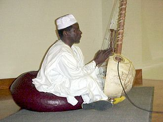 Dyula people - Mandinka Griot Al-Haji Papa Susso performing songs from the oral tradition of the Gambia on the kora