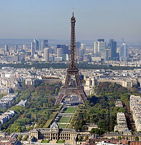 Paris, with the Eiffel Tower in the foreground and the skyscrapers of La Défense in the background